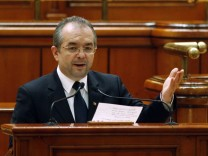 File picture shows Romania's Prime Minister Emil Boc addressing the Parliament in Bucharest