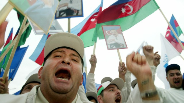 Demonstrators shout and wave Azeri flags during a pro-government rally in Baku