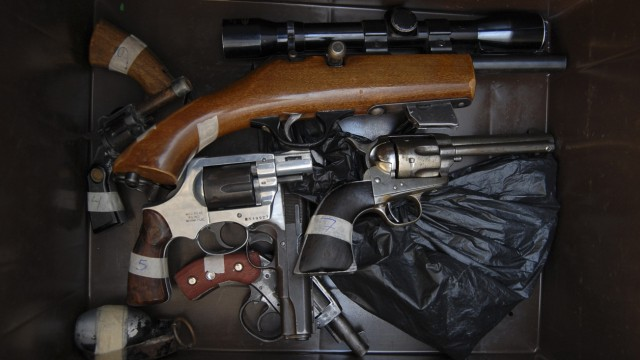 Weapons handed in by residents are seen in a box during the 'Guns Exchange Program' in the municipality of Garcia