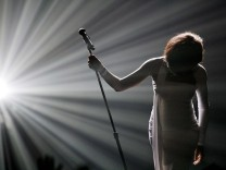 File photo of Whitney Houston bowing after performing at the 2009 American Music Awards in Los Angeles