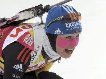 World cup leader Neuner of Germany competes to win the women's 7.5 km sprint competition at the Biathlon World Cup in Kontiolahti
