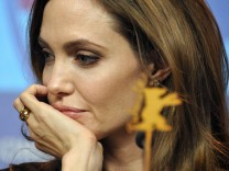 U.S. actress and director Jolie attends news conference to promote movie 'The Land Of Blood And Honey' at 62nd Berlinale International Film Festival in Berlin