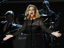 Adele performs 'Rolling in the Deep' at the 54th annual Grammy Awards in Los Angeles