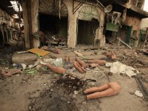 Mannequins are seen outside destroyed shops in Tripoli street in central Misrata