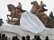 Bronze statues of late North Korean leader Kim Jong-il and his father and the late North Korean founder Kim Il-sung are unveiled to the public in Pyongyang