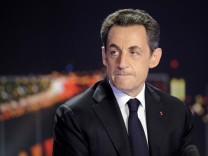 France's President Sarkozy is seen prior to formally declaring his candidacy for a second term during the prime time news programme at the studios of  TF1 French Television near Paris