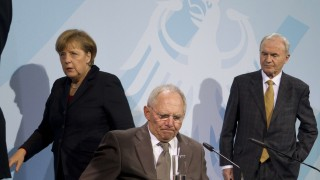 German Chancellor Merkel, Finance Minister Schaeuble and New Financial Market Architecture expert group member Issing address media after talks in Berlin