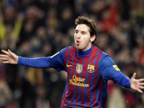 Barcelona's Messi celebrates after scoring his fourth goal against Valencia during their Spanish first division soccer match in Barcelona