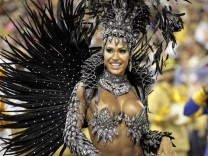 Drum queen Barbosa of the Unidos da Tijuca samba school dances during the annual Carnival parade in Rio de Janeiro's Sambadrome