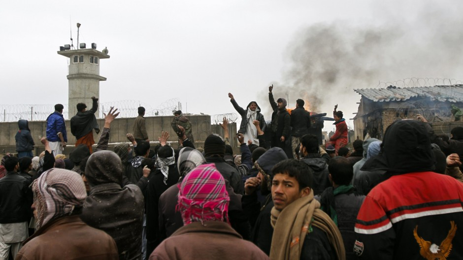Afghans shout anti-U.S slogans during a protest outside the U.S. military base in Bagram
