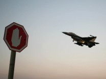 File picture of an Israeli Airforce F-16 fighter plane flying above a traffic sign in northern Israel