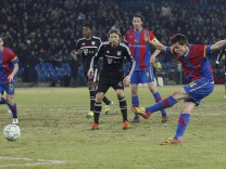 FC Basel's Stocker shoots and scores the winning goal for the team during their Champions League last 16 first leg soccer match against Bayern Munich in Basel