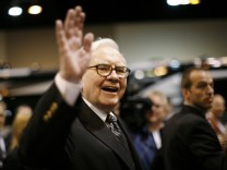 Billionaire financier and Berkshire Hathaway CEO Warren Buffet greets shareholders during the Berkshire Hathaway Annual Shareholders meeting in Omaha