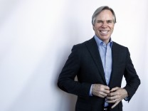 Designer Tommy Hilfiger poses for a portrait after giving a review a preview of his Fall/Winter 2012 collection show
