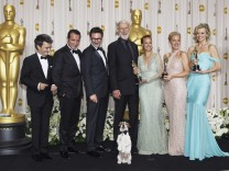 Producer Langmann, Dujardin, director Hazanavicius, Cromwell, Bejo, Miller and Pyle hold their Oscars after winning best picture for 'The Artist' backstage at the 84th Academy Awards in Hollywood