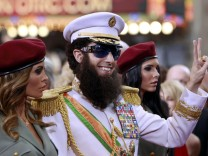 Actor Sacha Baron Cohen arrives in character from his upcoming film 'The Dictator' at the 84th Academy Awards in Hollywood