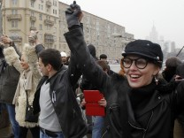 TV Personality Sobchak attends a protest rally called The White Ring with opposition supporters wearing white ribbons and carrying balloons and other white objects while they build a human chain along the Garden Ring road in Moscow