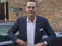 File photograph shows News International Chairman, James Murdoch, arriving at the News International headquarters in London