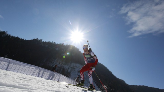 An unidentified biathlete skis during a practice session at the Biathlon World Championships in Ruhpolding
