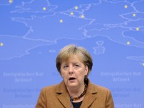 Germany's Chancellor Merkel addresses a news conference at the end of a EU leaders summit in Brussels