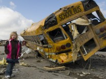 Indiana National Guard handout photo of a destroyed school bus in Henryville