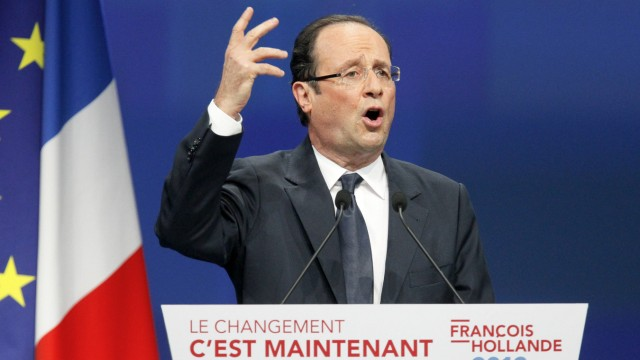 Hollande, Socialist Party candidate for the 2012 French presidential election, delivers a speech during a campaign rally in Dijon