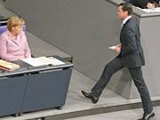 Merkel, Guttenberg, Reuters