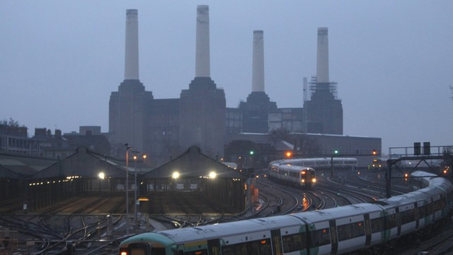 Trains travel to and from Victoria station past Battersea Power Station in central London