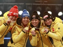Germany's Bachmann, Neuner, Goessner and Henkel pose during the medal ceremony for the women 4 x 6.0 km relay race at the Biathlon World Championships in Ruhpolding