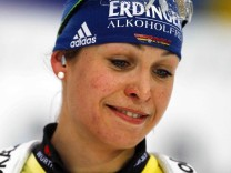 Germany's Neuner reacts after missing a medal in the women's 12.5 km mass start race at the Biathlon World Championships in Ruhpolding