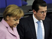Merkel, Guttenberg, dpa