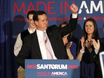 Republican U.S. presidential candidate Rick Santorum is applauded by members of his family as he addresses supporters at his Alabama and Mississippi primary election night rally in Lafayette