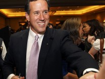 Republican U.S. presidential candidate Rick Santorum shakes hands with supporters after speaking at his Alabama and Mississippi primary election night rally in Lafayette