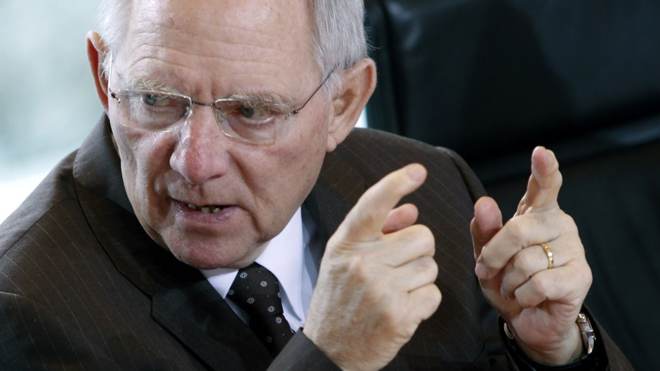 German Finance Minister Schaeuble gestures at the weekly cabinet meeting in Berlin
