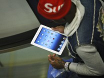 Customer checks his new iPad after purchasing it at department store in Manhattan, New York
