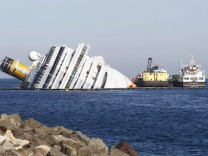 An oil tanker and oil recovery sea platform are seen during the extraction of fuel from Costa Concordia at Giglio island