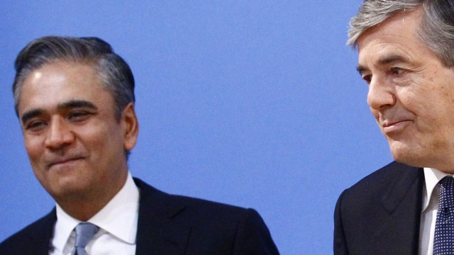 Ackermann outgoing CEO of Deutsche Bank AG stands next to his designated successor Jain prior to bank's annual news conference in Frankfurt