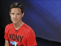 File photo Jason Russell, co-founder of non-profit Invisible Children and director of 'Kony 2012' viral video campaign, poses in New York
