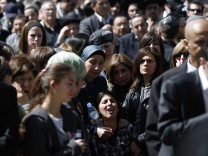 The mother mourns during the joint funeral service in Jerusalem for victims of Monday's shooting in Toulouse