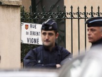 French CRS police secure a street during a raid on a house to arrest suspects in the killings of three children and a rabbi on Monday at a Jewish school, in Toulouse