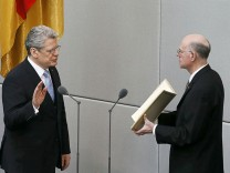 Newly elected German President Gauck is sworn-in by president of the German lower house of parliament Lammert at the Reichstag in Berlin