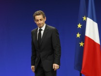 France's President and UMP party candidate for the 2012 French presidential elections Sarkozy leaves after delivering a speech at a political rally in Strasbourg