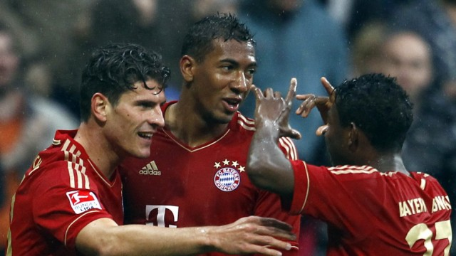 Munich players celebrate during their German Bundesliga first division soccer match against Hanover 96 in Munich