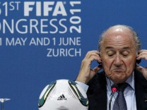 FIFA president Blatter reacts during a news conference after being re-elected as president of world soccer's governing body during the 61st FIFA congess in Zurich