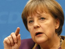 German Chancellor and Christian Democratic Union party leader Merkel attends a news conference in Berlin