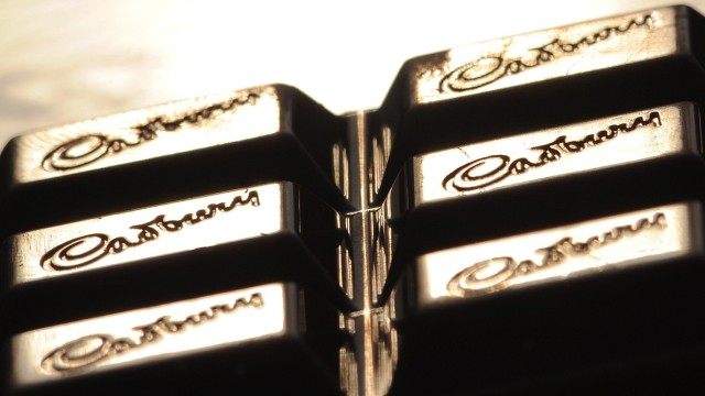 The Cadburys logo is seen on a bar of chocolate