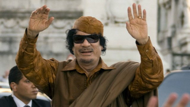 Libya's leader Gaddafi greets Romans from the sunroof of his limousine while forming an impromptu parade in Piazza Venezia in Rome