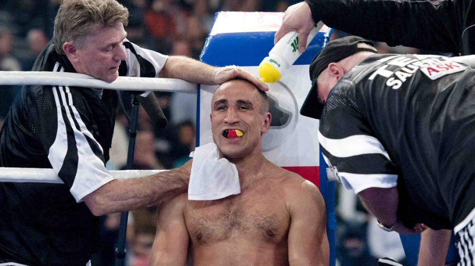 Germany's former middleweight world champion Abraham sits in corner during their super-middleweight WBO continental fight against Poland's Wilczewski in Kiel