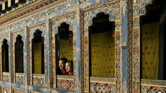 Monks look out of a temple in Tango monastery on the outskirts of Thimphu