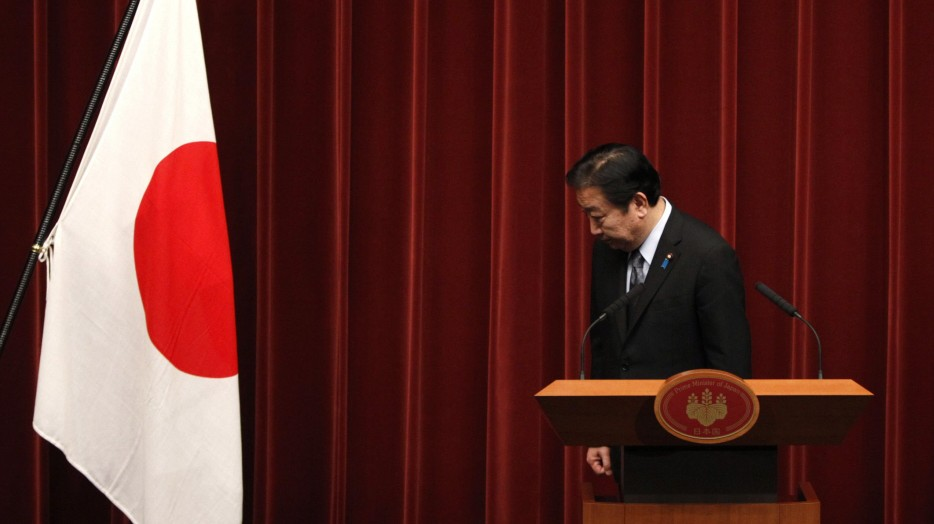 Japan's PM Yoshihiko Noda bows during a news conference at his official residence in Tokyo